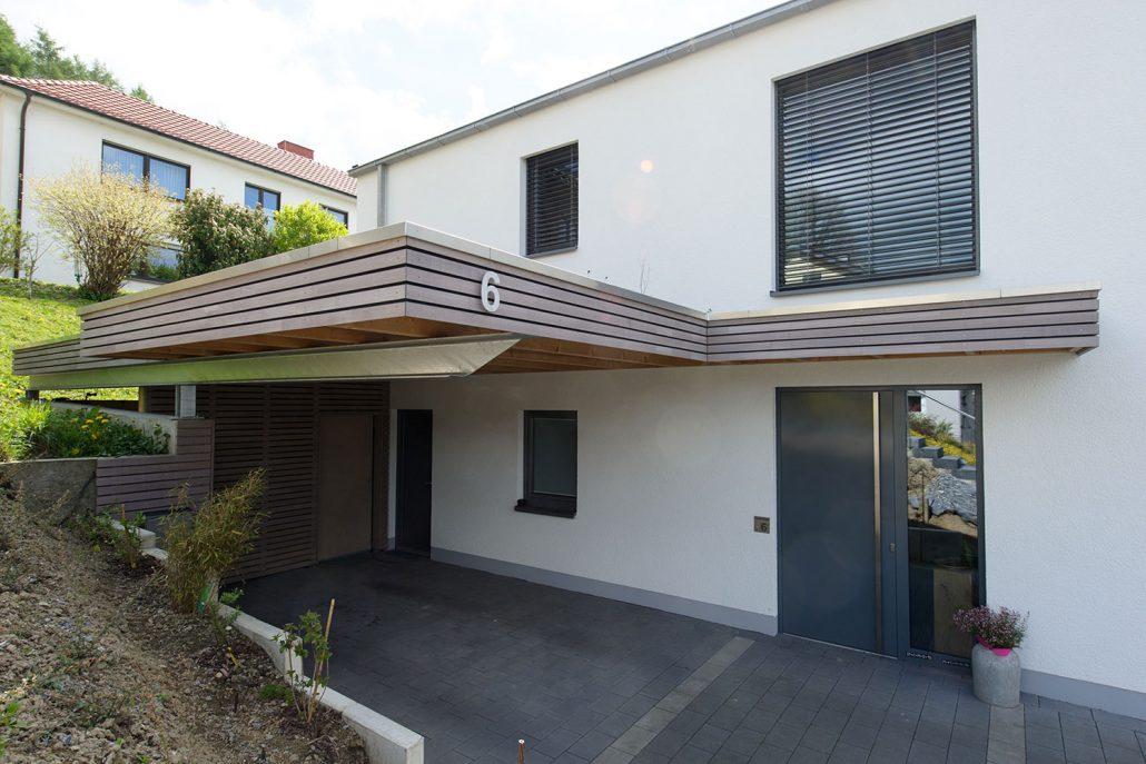 Holzrahmenhaus mit Carport Bürger – BAUART THIELE